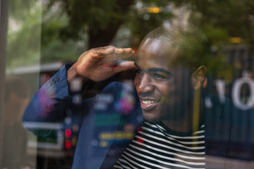 Young Black Man Looking Through the Window