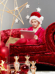 Cute girl got tablet pc on Christmas Eve