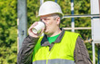 Electrician Engineer drink coffee in a workplace