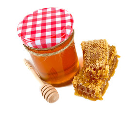 fresh honey and honeycomb isolated on white