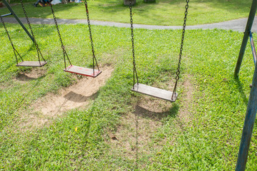 Empty chain swings in children playground