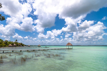 pier and palapa hut in Bacalar lagoon - Mexico