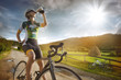 Cyclist is drinking water from the sport bottle - 70254271