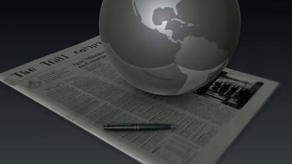 新聞の上で回る地球