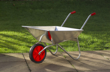 galvanised steel wheelbarrow cart in garden