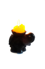Side elephant candlestick with burning candle