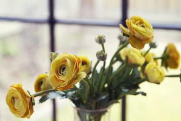 Close up of fake yellow flowers horizontal