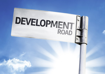 Development written on the road sign