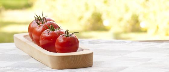 Tomatos on wooden plate