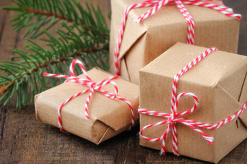 Three handcrafted Christmas gifts wrapped in brown paper