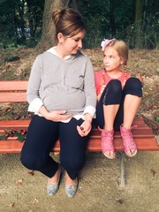 Mom with daughter on a bench