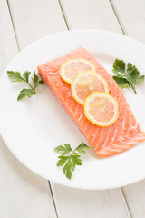 Fresh salmon with spices and lemon