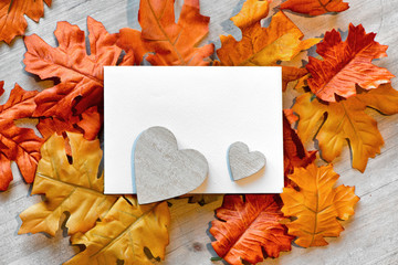 Wooden Hearts and Blank Note with Autumn Leaves
