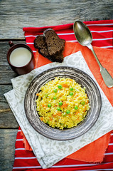Indian vegetarian pilaf, Biriyani, with carrots and green peas