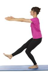 Senior woman doing pilates exercises