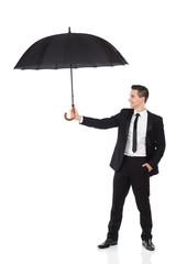 Insurance agent holding open umbrella.