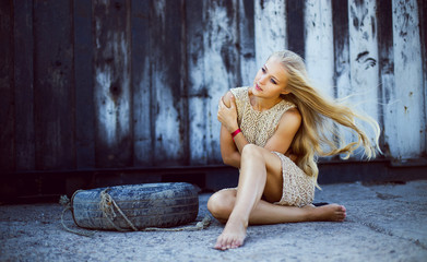 Emotive portrait of young beautiful woman with long blonde hair