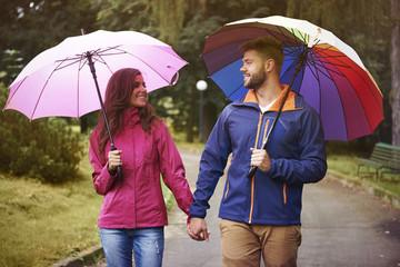 Walking in rain under the umbrella with my baby