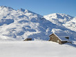 canvas print picture - Picturesque traditional cabin in the Alps in winter