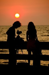 Couple taking photo in evening