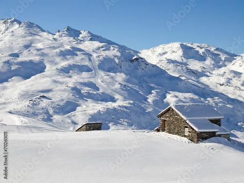 canvas print picture Picturesque traditional cabin in the Alps in winter