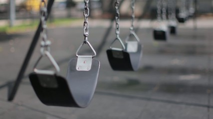 Swings in a playground for children to play