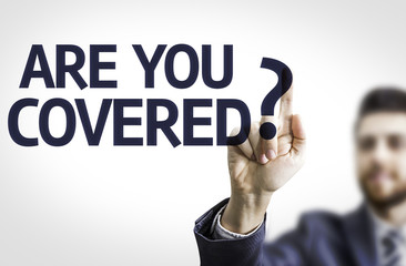 Business man pointing the text: Are you Covered?