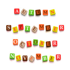 Words autumn, September, October, Novtember with colorful blocks