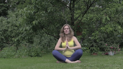Healthy pregnant woman relax doing yoga in nature outdoors