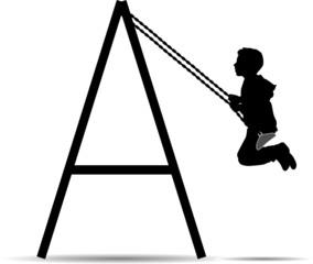 Boy swinging on a swing in the park