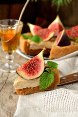 piece Tart with caramel cream and fresh figs served on a linen