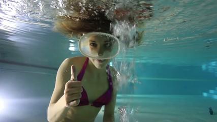 Female diver show hand signal