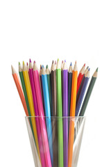 colored pencils in a glass isolated on white background