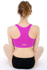 Frau in Sportbekleidung bei Yoga und Meditaion