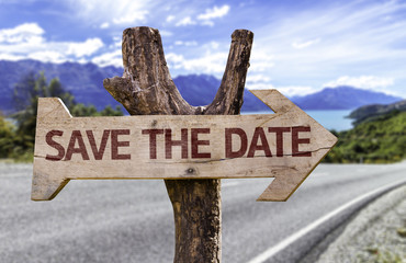 Save The Date wooden sign with a road background