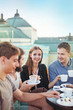 people enjoying coffee together with friends (focus on woman's e