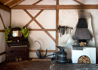 Rustic interior in an old forge and piano