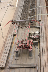 View from above of an electric train with a red contact network