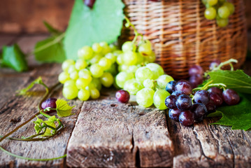 Red and Green Grapes on wooden table