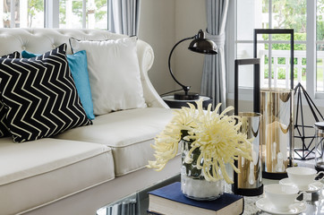 luxury white sofa in living room with flower in vase