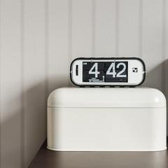 modern alarm clock on white plastic box