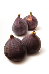 Fresh turkish figs isolated on a white studio background.