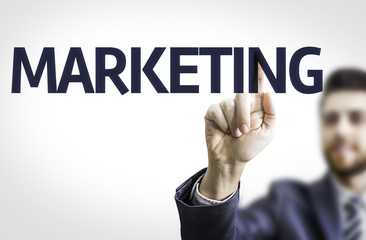 Business man pointing the text: Marketing
