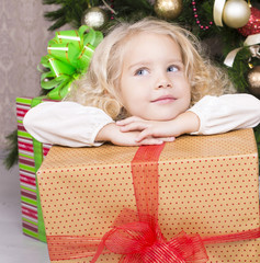 cute little girl holding Christmas present