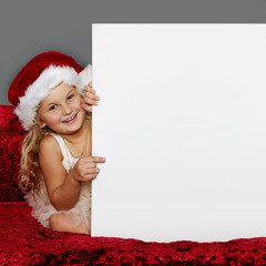 Cute girl shows voucher for christmas