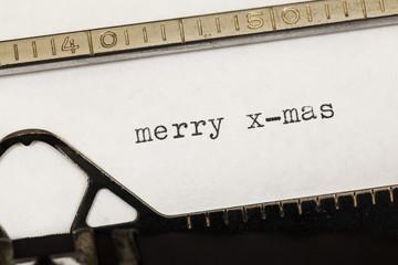 Merry x-mas written on old typewriter.