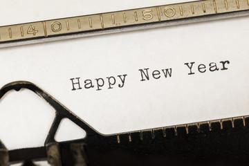 Happy new year written on old typewriter.