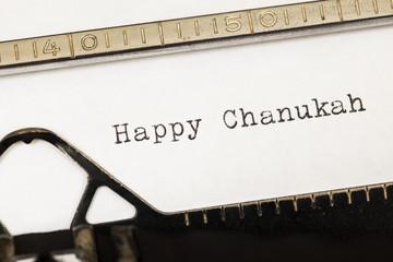 Happy Chanukah written on old typewriter.