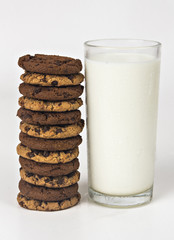 Milk glass  and cookies on white background