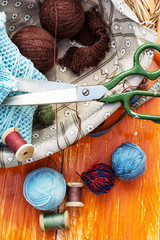ball of knitting yarn and sewing accessories